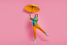 Full Size Photo Of Surprised Girl Catch Her Shine Parasol Scream Wow Omg Wear Blue Red Headwear Pants Winter Shoes Sweater Isolated Over Pink Color Background