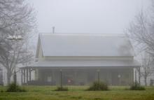 Morning Fog Surrounds A Modern...