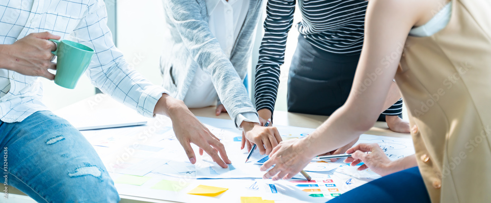 Fototapeta close up of creative asian business people brain storm meeting Strategy,Planning  analysis and young business team discussing and presentation  roadmap new business development in modern office