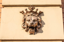 Gold Lions Head On The Wall Of...