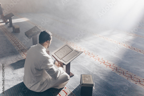 Quran - holy book of Islam mosque Muslim in mosque enuntiat Quran in Ramadan Canvas Print