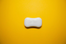 White Soap On Yellow Background