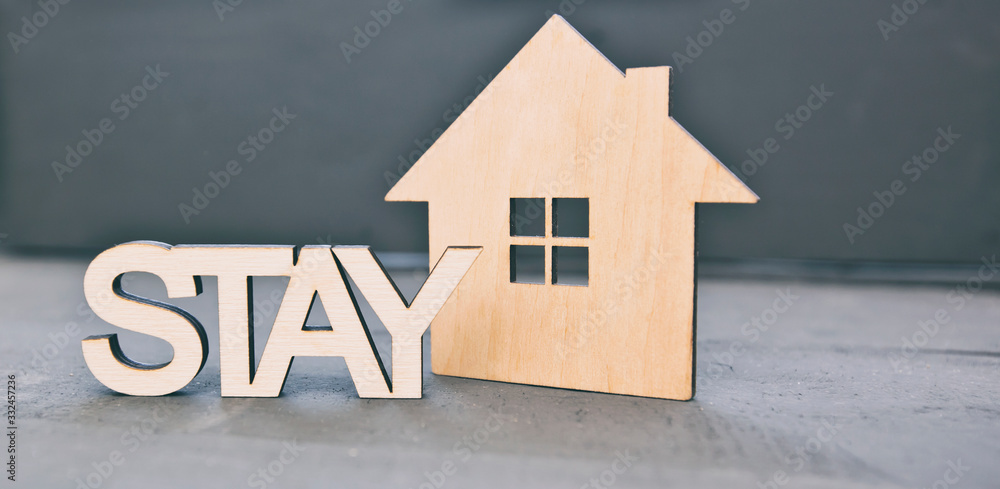 Fototapeta The wooden little house on the wooden desk and word
