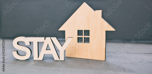Obraz The wooden little house on the wooden desk and word