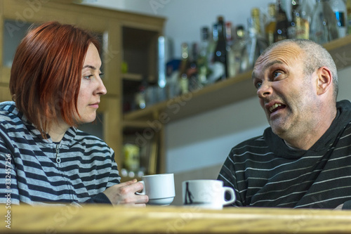 Married couple in quarrel in kitchen at home Wallpaper Mural