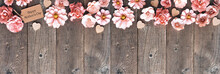 Happy Mothers Day Corner Border With Paper Flowers And Gift Tag. Overhead View Against A Rustic Wood Banner Background. Copy Space.