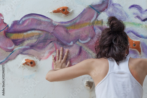 A girl practicing rock climbing at home Wallpaper Mural