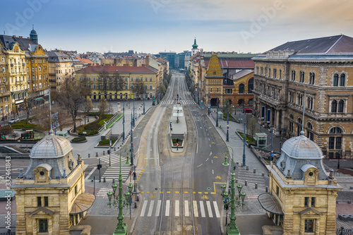 Budapest, Hungary - Aerial view of Fovam square and totally empty streets at Vamhaz Boulevard (Vamhaz korut) and Central Market Hall. No people and quarantine during the Coronavirus pandemic
