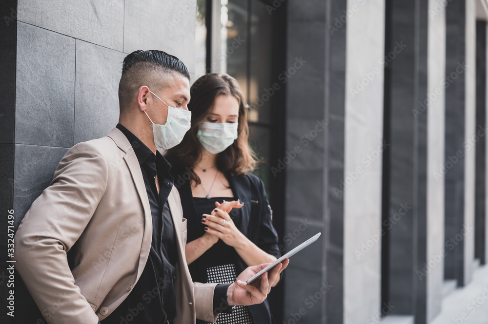 Fototapeta Business people wear medical masks to talk with partners, Covid 19 protection