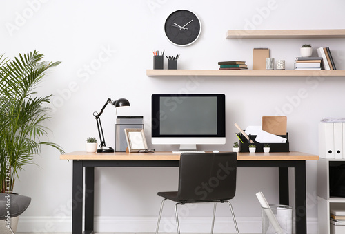 Obraz Modern computer on table in office interior. Stylish workplace - fototapety do salonu