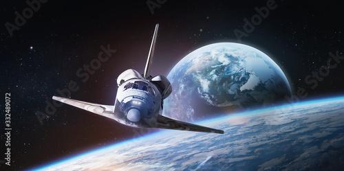 Obraz na plátně Space shuttle on orbit of the Earth