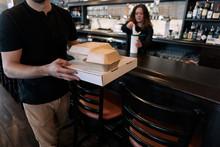 Crisis: Man Picks Up To Go Food During Social Distancing Closure