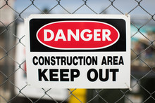 Danger Construction Area Keep Out Sign On Metal Chain Link Fence
