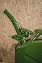 Detail View Of A Long Filling Neck Or Funnel On A Green Metal Jerry Can For Fuel. Detail View Of A Funnel On A Jerry Can