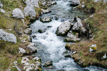 From Above Splashing Mountain River Streaming Through Rocky Mountains In Peaks Of Europe, Asturias, Spain