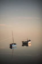 Still Boats Over Pastel Sky An...