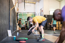 Athlete Adjusting Weights On B...