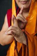 Crop Tibetan Woman In Traditional Clothes With Prayer Beads Doing Mudra Gesture With Hands