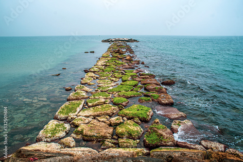 Fotomural Stone jetty at sea. Stone jetty at sea.