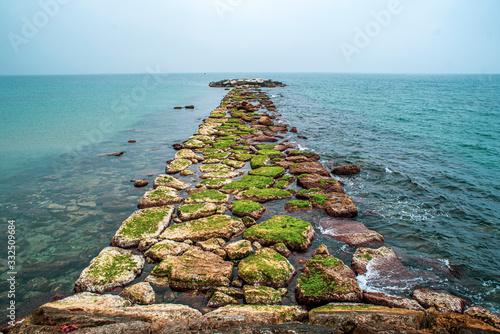 Stone jetty at sea. Stone jetty at sea. Wallpaper Mural
