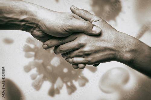Fototapeta Image of humans handshake on coronavirus background. Concept of rescue from global pandemic. obraz