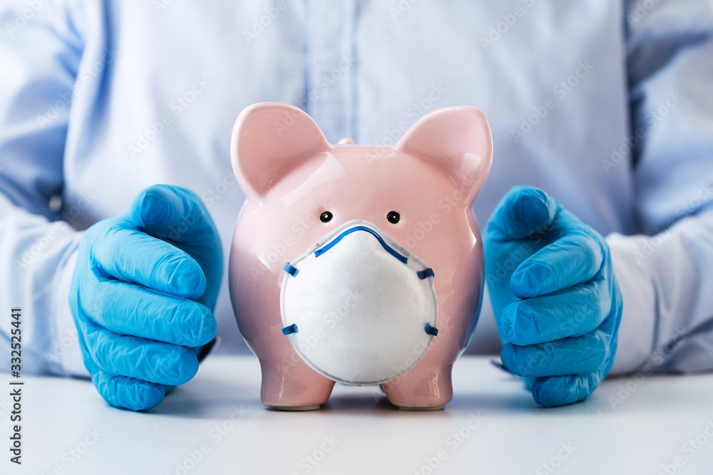 Fototapeta Human Hand Protecting Piggy Bank