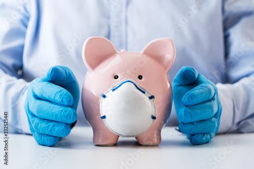 Fototapeta Human Hand Protecting Piggy Bank obraz