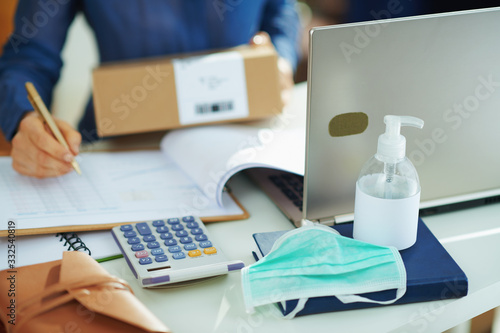 mata magnetyczna medical mask and hand disinfectant and woman with parcel