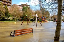 Swings In The Flooded Park
