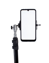 Smartphone Mounted On A Black Tripod In A Vertical Position On A Light Isolated Background Tilted To The Right.