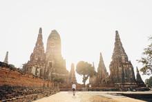 Traveler Tourist Man Walking At Chaiwatthanaram Temple Of Ayutthaya In The Thailand. Ayutthaya Historical Park, Ayutthaya, Thailand.