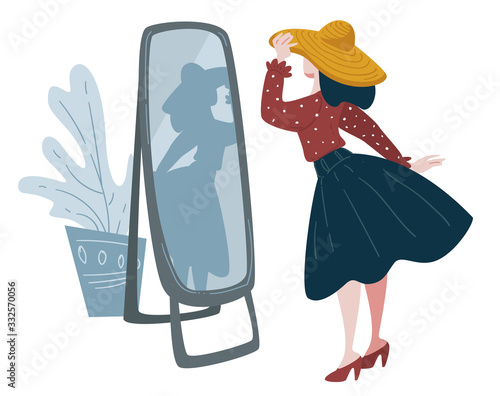 Woman trying on hat in front of mirror, fashion shopping Wall mural