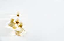 Yellow Fish Oil Capsules On A White Background