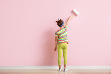 Little Girl Painting Wall In R...