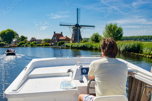 Valokuva Family vacation, summer holiday travel on barge boat in canal, man by steering w