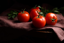 Tomatoes On A Dark Background,...