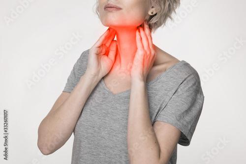 Fototapeta Female checking thyroid gland by herself
