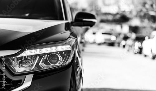 Obraz Gray modern car closeup on black and white background - fototapety do salonu