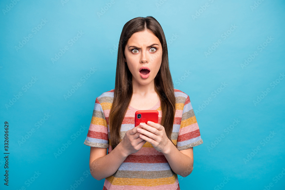 Fototapeta Close-up portrait of her she nice lovely worried sullen grumpy irritated mad angry girl using device browsing fake news fail failure isolated over bright vivid shine vibrant blue color background