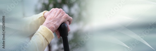 Obraz Old woman hands holding a cane; panoramic banner - fototapety do salonu