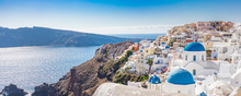 Amazing Panoramic Landscape, Luxury Travel Vacation. Oia Town On Santorini Island, Greece. Traditional And Famous Houses And Churches With Blue Domes Over The Caldera, Aegean Sea