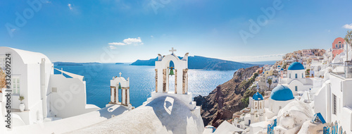 Fototapeta Amazing panoramic landscape, luxury travel vacation. Oia town on Santorini island, Greece. Traditional and famous houses and churches with blue domes over the Caldera, Aegean sea obraz