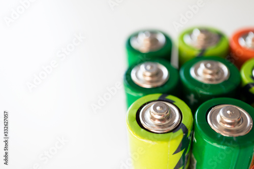 Various alkaline batteries on white background with selective focus Canvas Print