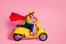 Profile Side View Of His He Nice Attractive Cheerful Cheery Purposeful Guy Driving Moped Fast Wearing Cape Mantle Rescuing People Isolated Over Pink Pastel Color Background