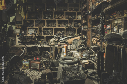 old abandoned mechanical workshop with many messy things Canvas Print
