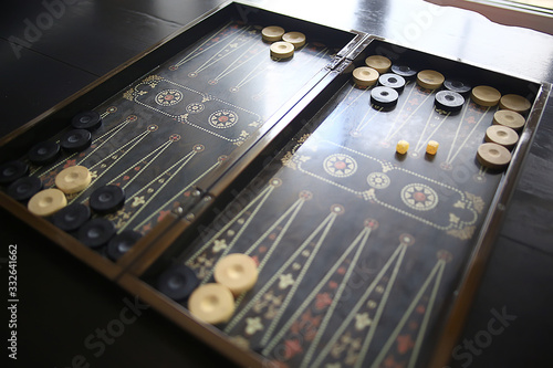 Photo backgammon traditional oriental game, macro background gambling