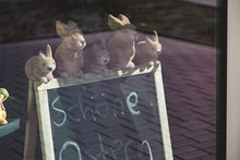 5 Easter Bunny Figures On A Board In A Window.