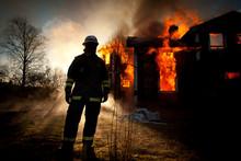 Burning House In Woodland Caug...