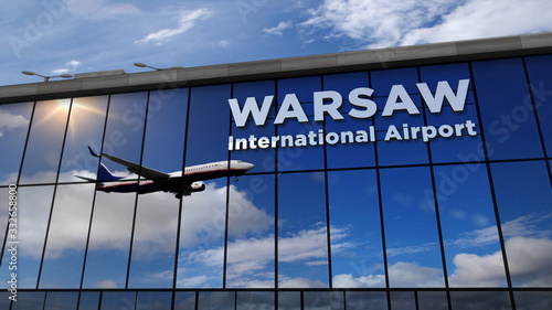 Airplane landing at Warsaw Poland mirrored in terminal