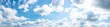 gorgeous panorama of cloudscape in springtime. weather background with dynamic cloud arrangement on a blue sky. sunny and windy day, good weather forecast concept
